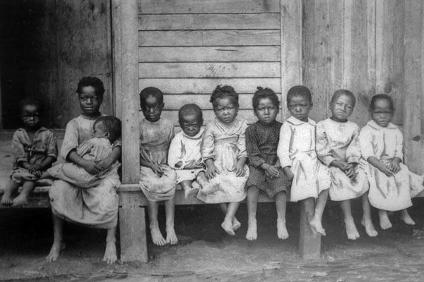 American Slavery: children on porch of cabin